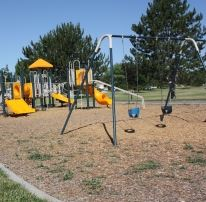 Playground Structure and Swingset in a Sandy Lot