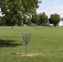 Disc Golf Net by an Open Field