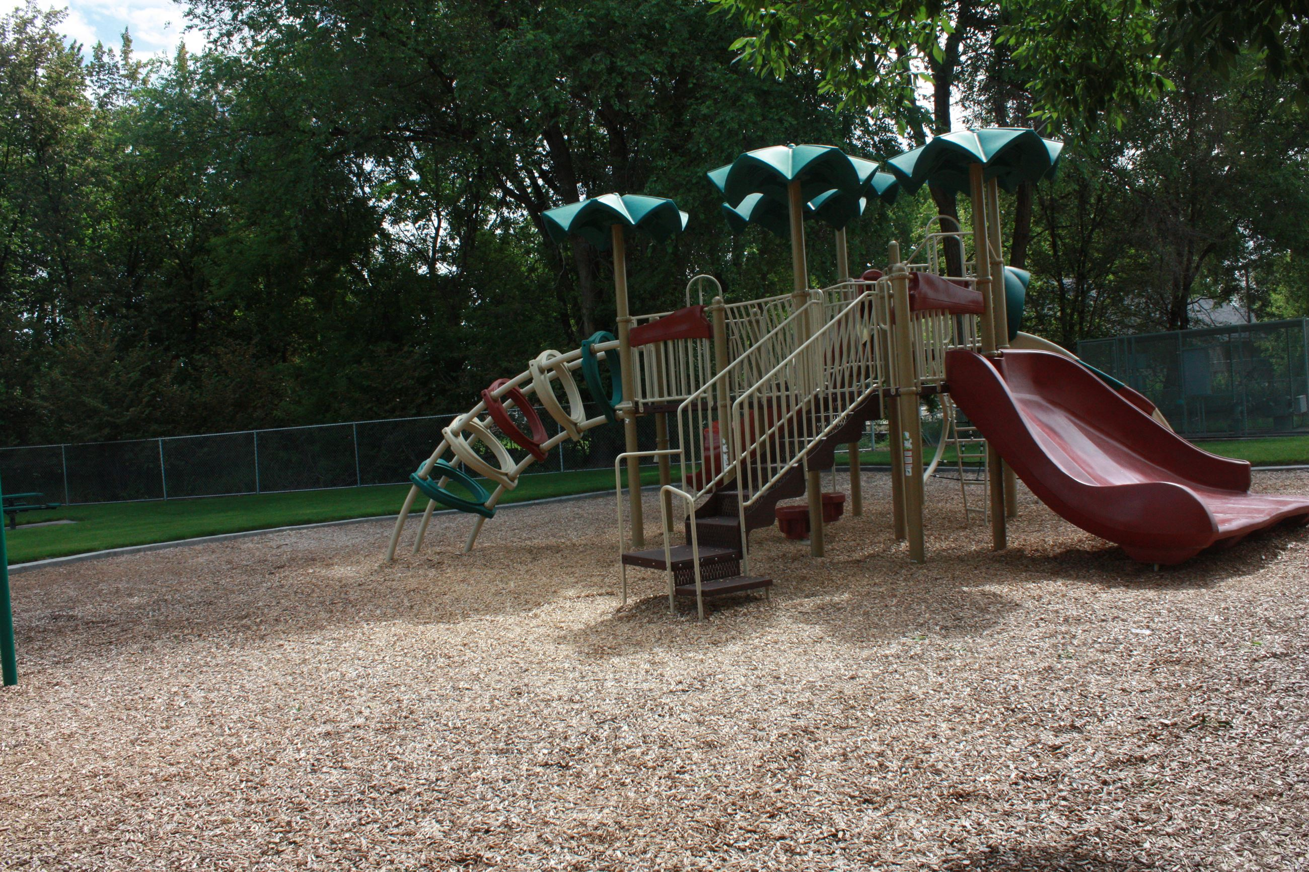 Green, tan, and maroon play structure