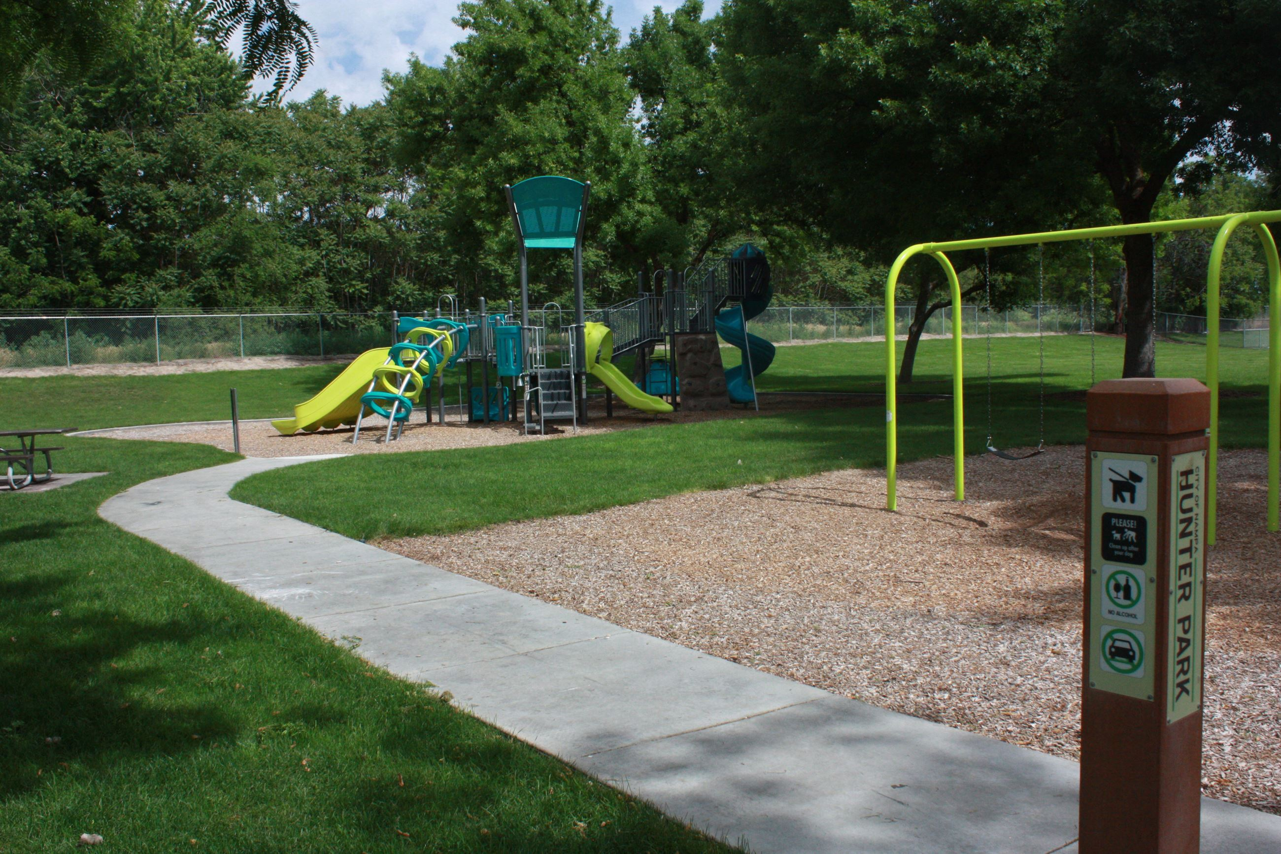 Green and teal play structure