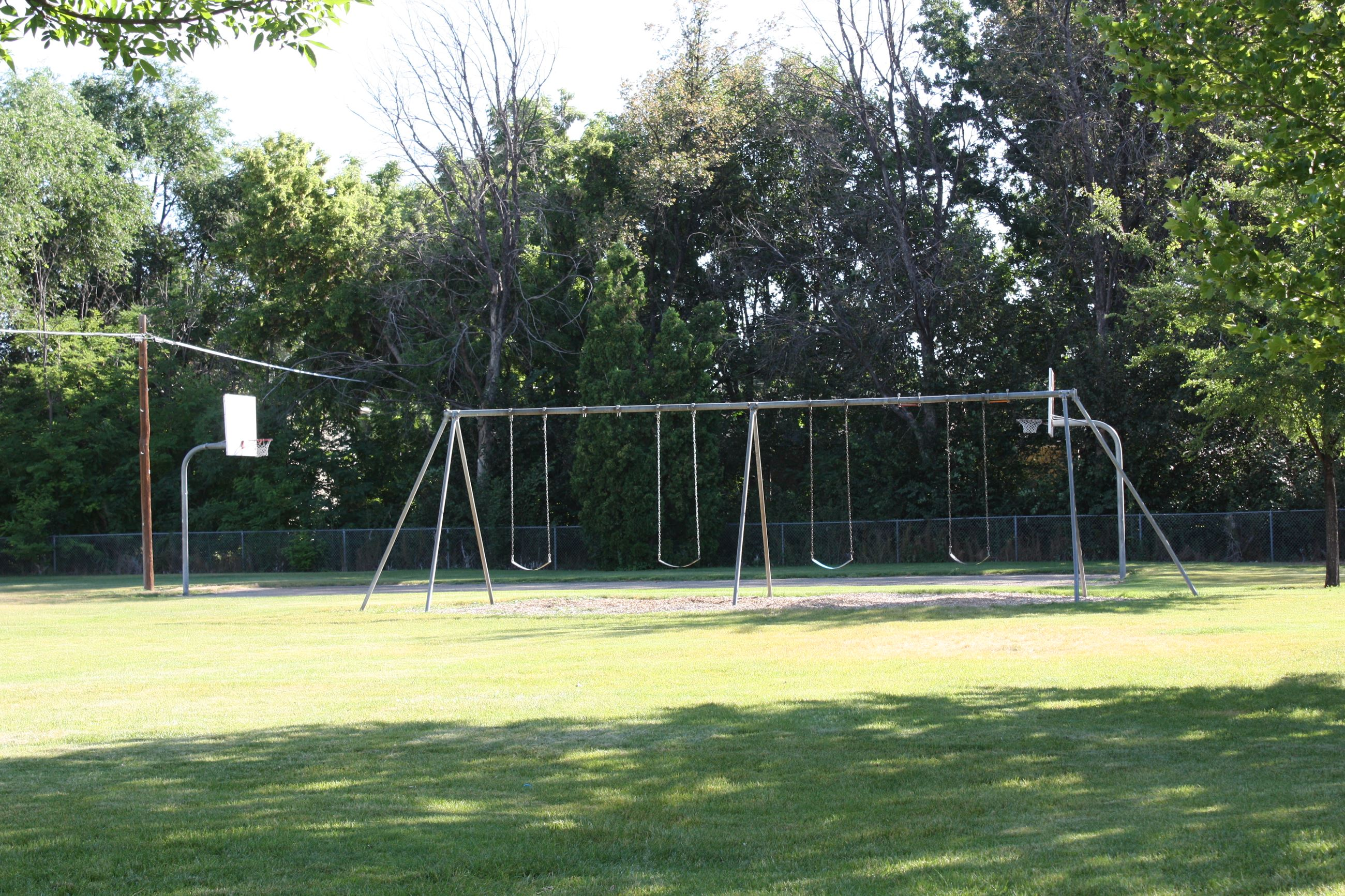 Swings and basketball courts at Indian Creek Park
