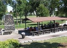 Park Picnic Shelter with People Under It