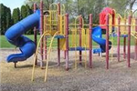 Red, Blue, and Yellow Play Structure at City Acres Park
